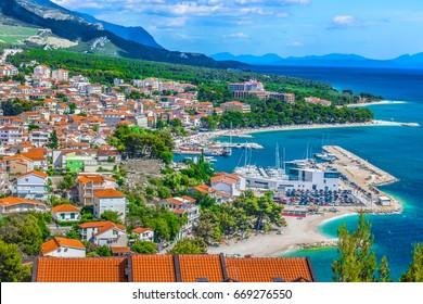 Aerial view on Adriatic Sea and Baska Voda place in Makarska Riviera, Dalmatia region, popular tourist summer resort in Croatia, Mediterranean. / Selective focus.