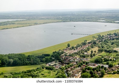 Aerial view on the approach to London's Heathrow Airport of the Wraysbury Reservoir in Slough, Berkshire which supplies water to West London.  Beyond the water is part of the M25 Motorway.