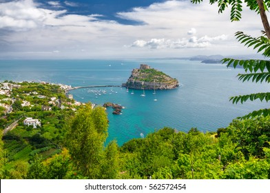 Aerial view on Aragonese castle through green foliage, Ischia, Italy