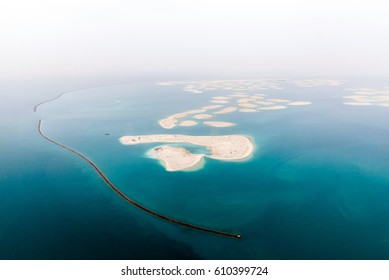 Aerial view on artificial world islands of Dubai