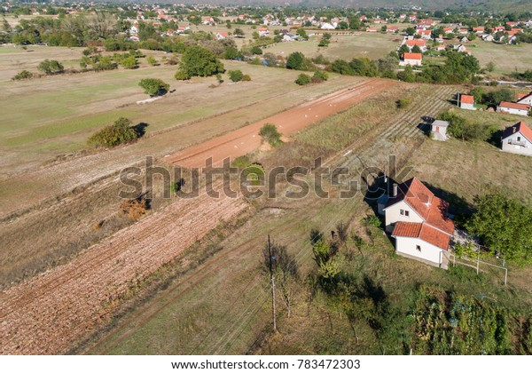 Aerial view on autumn fields with village houses. Montenegro.