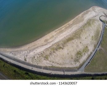 aerial view on beach, coast of sea and road from above in holywood northern ireland