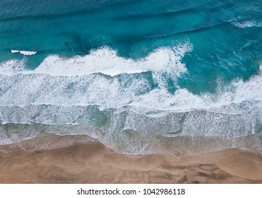 Aerial view on the beach and waves. Beautiful natural landscape from air