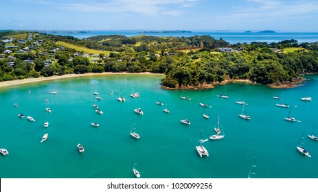 Aerial view on beautiful bay at sunny day with sandy beach and residential suburbs on the background. Waiheke Island, Auckland, New Zealand