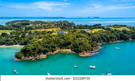 Aerial view on a beautiful harbour surrounding rocky peninsula with residential houses. Waiheke Island, Auckland, New Zealand