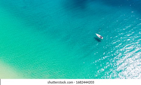 Aerial view on boat on turquoise water sea. Top view on yacht, Fuerteventura Spain