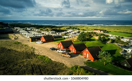 Aerial view on camping area in Norway. There is a coastline, sandy beach, and near by lake. Norway.