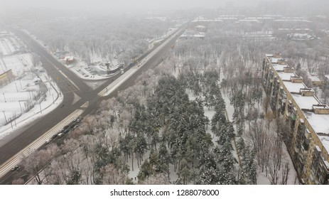 Aerial view on city park between road and building in winter time. (Dnepr, Dnepropetrovsk, Dnipropetrovsk). Ukraine