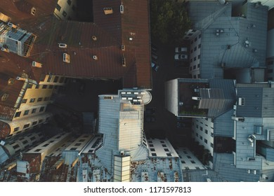 Aerial view on city rooftops, small european city from drone point of view vintage film look