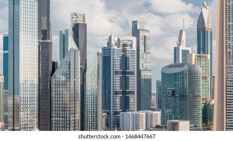 Aerial view on downtown and financial district in Dubai timelapse, United Arab Emirates with skyscrapers and highways. Cloudy sky