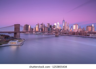 Aerial view on East river with Brooklyn Bridge and financial district at sunrise,long exposure