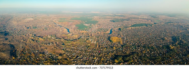 Aerial view on eastern Europe settlement in autumn noon light. Average rural view.