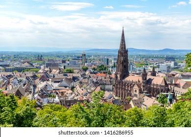 Aerial view on Freiburger Munster Cathedral church, Rhine valley (Rheintal). Freiburg im Breisgau, Baden-Wurttemberg, Germany.