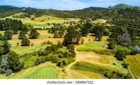 Aerial view on a golf field with green hills on the background. Waiheke Island, Auckland, New Zealand.