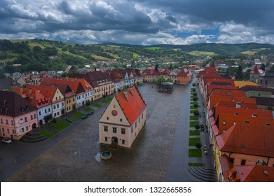 Aerial view on historic town square in Bardejov with colorful facades of old houses listed in UNESCO world heritage up above from tower of church after summer storm