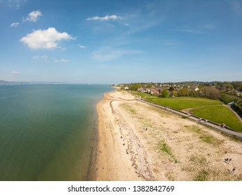Aerial view on houses near beach on coast of Irish Sea in Holywood Northern Ireland. Countryside view against clear blue sky