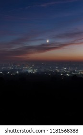 Aerial view on Ivano-Fankivsk city after the sunset with the moon
