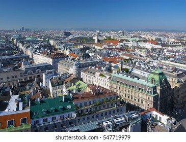 Aerial view on Karntner street in the center of city, State Opera roof, St.Augustin church, Hofburg, Museum Quarter and skyscrapers on background seen from St. Stephen's Cathedral in Vienna, Austria