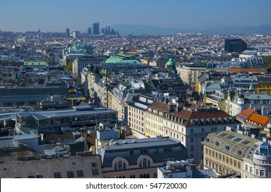 Aerial view on Karntner street in the center of city, State Opera roof and skyscrapers on background seen from St. Stephen's Cathedral in Vienna, Austria