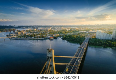 Aerial view on kiev city at sunset. Warm tone. Moskovsky bridge on front.
