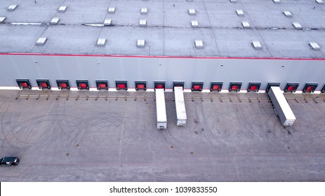 Aerial view on loading bays in distribution center. Aerial