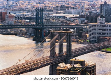 Aerial view on Lower Manhattan, New York, Brooklyn Bridge and Manhattan Bridge over East River, USA. Skyline with skyscrapers. Brooklyn Heights on the background.