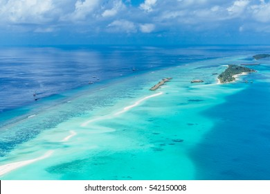 Aerial view on Maldives island, Ari atoll. Tropical islands and atolls in Maldives from aerial view. Summer vacation holiday landscape background.