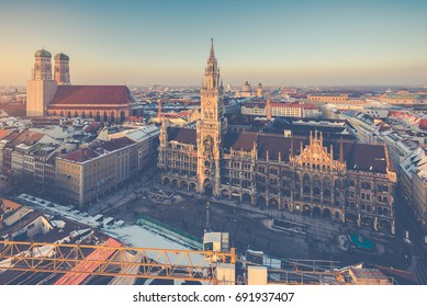 Aerial view on Munich old town hall or Marienplatz town hall and Frauenkirche in Munich, Germany, vintage rtyle process