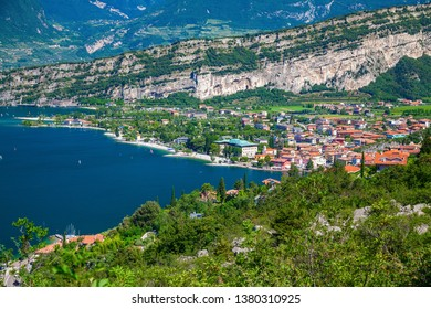 aerial view on the northern part of Garda Lake with mountains and small village Torbole, Italy