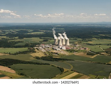 Aerial view on Nuclear power plant Temelin in the Czech Republic. Operating buildings and control rooms. Clouds of steam derailing from a nuclear power station tower.
