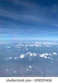 Aerial view on the plane Strange white stratocumulus clouds in the atmosphere above the blue sky.no focus