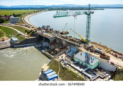 Aerial view on the reconstruction of the dam at the big large lake