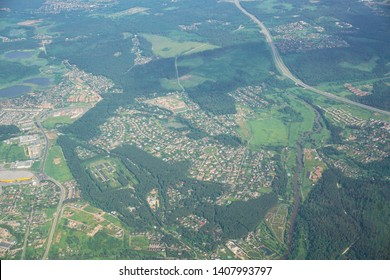 Aerial view on the residential area in Moscow region.View on cottage village from the airplane window