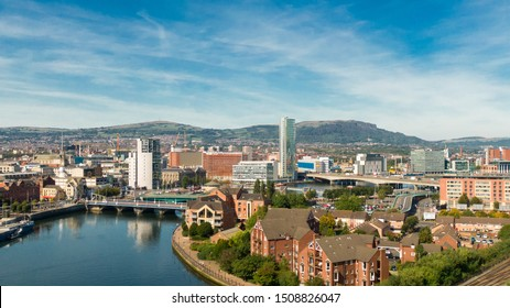 Aerial view on river and buildings in City center of Belfast Northern Ireland. Drone photo, high angle view of town