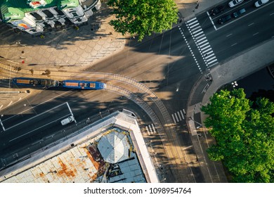 Aerial view on road with cars over river in city of Riga, Latvia, tram rails