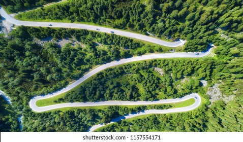 Aerial view on the road and forest. Natural landscape from drone. Aerial landscape from air in the Austria