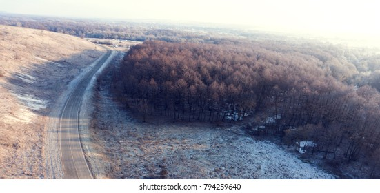 Aerial view on road and forest landscape in winter season
