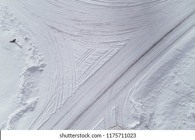 Aerial view on road in winter time, road surrounded with forest trees, car driving in winter time. Rural winter area