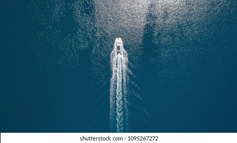 Aerial view on the sea and boat. Beautiful natural seascape at the summer time - Shutterstock ID 1095267272