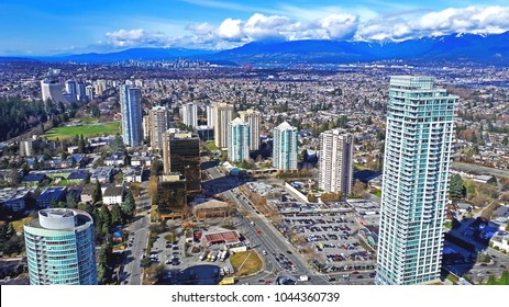 The aerial view on skycrapers, buildings and mountains in Burnaby, Metrotown area, Vancouver, BC on March 9,2018