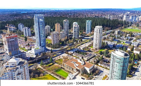 The aerial view on skycrapers, buildings and football field in Burnaby, Metrotown area, Vancouver, BC on March 9,2018