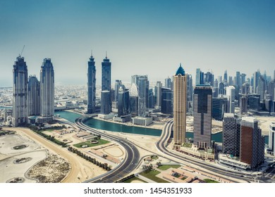 Aerial view on skyscrapers of Dubai, UAE, on a summer day