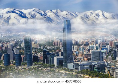 Aerial view on skyscrapers of Financial District of Santiago, capital of Chile under early morning fog