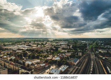 Aerial view on small city with train terminal, sunset time over city. Daugavpils, Latvia