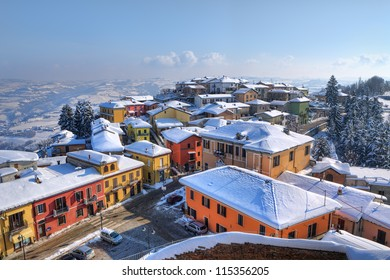 Aerial view on small town, houses and roofs covered with snow at Diano D'Alba in Piedmont, Northern Italy.