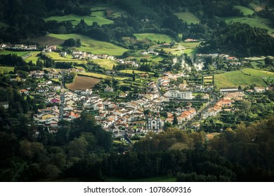 Aerial view on small village located near by volcanic lake - Furnas on Azores islands, Sao Miguel, Portugal. Red rooftops, the view from the top.