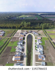 Aerial view on a street in Oosterwold in Almere. In this experimental district the residents arrange all infrastructure and NUTS facilities by themselves.