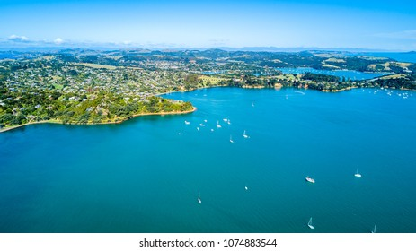 Aerial view on sunny beach with residential houses. Waiheke Island, Auckland, New Zealand.
