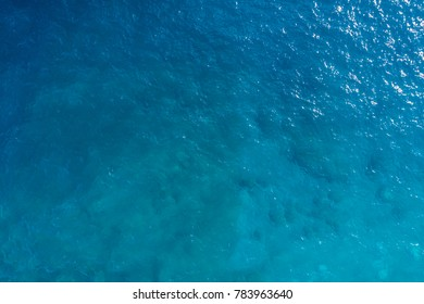 Aerial view on turquoise waves, water surface texture
