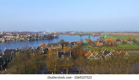 Aerial view on the typcal dutch houses and windmills in Zaandam